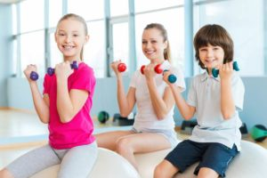 kids%20with%20dumbells%20on%20exercise%20ball_jpg_838x0_q67_crop-smart